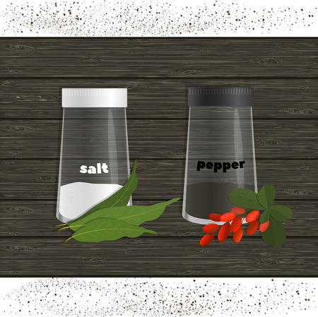 salt, pepper, bay leaf and a bunch of barberry on a background of wooden texture