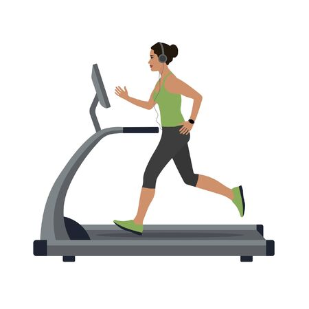woman runs on a treadmill and listens to music on headphones Фото со стока - 147125371