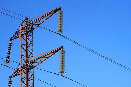 connection connections: High voltage electric poles on blue sky background