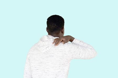African american man has a pain in his shoulder isolated on a white background Stock Photo