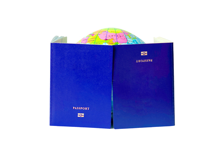 Two blue passport isolated on white background. A map or globe of planet earth. International travel identification document. The concept of travel. Stock Photo