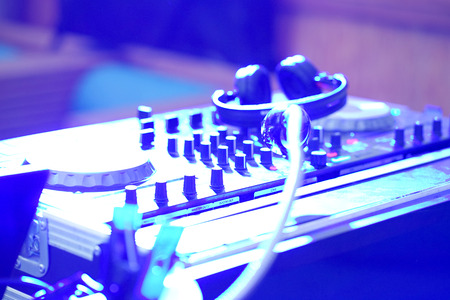 Club Dj Mixer. DJ stand in the light night club, concept entertainment. Blur turntables plate mixer night party pub with light Stock Photo