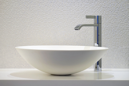 Bathroom interior sink with modern design. Interior of bathroom with washbasin and faucet Stock Photo
