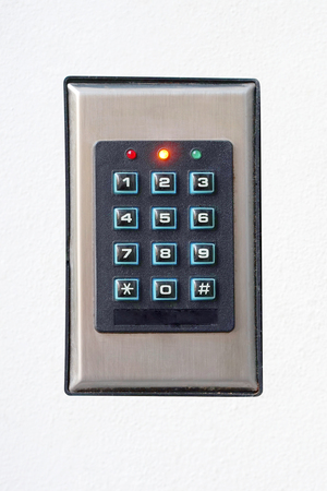 Secure password on keyboard for opening home house door. Isolated. Password code Security keypad system protected in Public Building. The security code combination to unlock the door 版權商用圖片