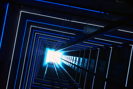 Elevator corridor in the building lit by Blue elumination. Futuristic elevator shaft is located in a high tower. Lift shaft in a residential building. Abstract, background. Bottom view. Banco de Imagens