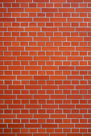 New Red Brick wall for background or texture. New red brick wall texture background Banco de Imagens