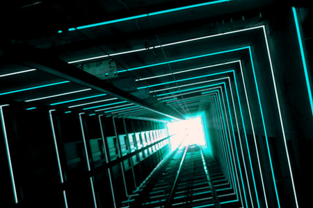 Elevator corridor in the building lit by Blue elumination. Futuristic elevator shaft is located in a high tower. Lift shaft in a residential building. Abstract, background. Bottom view. 版權商用圖片