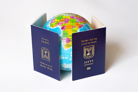 Blue Israeli biometric and non biometric passport isolated on white background. A map or globe of planet earth. International travel identification document. The concept of travel.