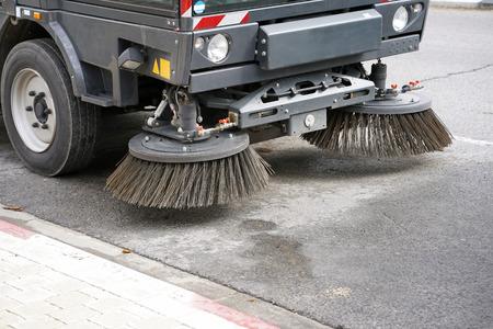 Street sweeper machine working
