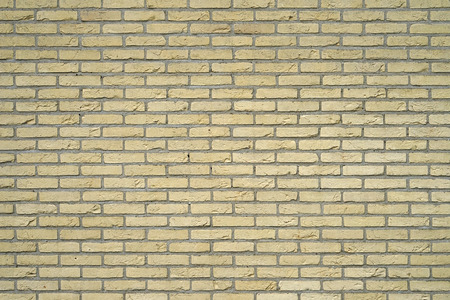 Yellow Brick wall for background or texture. Old red brick wall texture background