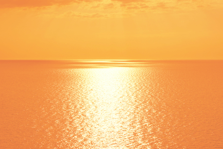 Orange sunset over Mediterranean Sea. Beautiful sunset over calm ocean. Sunrise or sunset over the sea with retro filter effect, summer concept 版權商用圖片