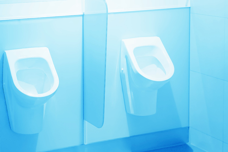 Close-up of toilet bowl. White toilet in the bathroom. Public toilet in the airport or restaurant, cafe. Imagens