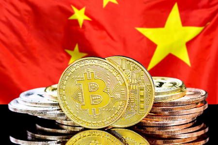 Bitcoins on the background of the flag China. Bitcoins on the background of the Chinese flag. Concept for investors in cryptocurrency and Blockchain technology in China. Фото со стока