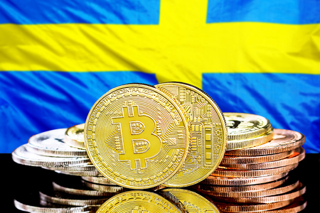 Bitcoins on the background of the flag Sweden. Bitcoins on the background of the Swedish flag. Concept for investors in cryptocurrency and Blockchain technology in Sweden.