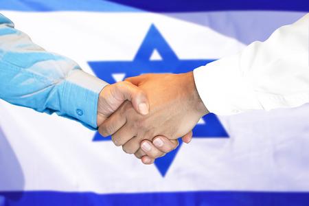 Business handshake on Israel flag background. Men shaking hands and Israeli flag on background. Support concept