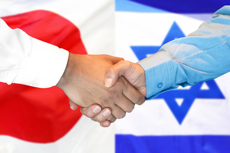 Business handshake on the background of two flags. Men handshake on the background of the Japan and Israel flag. Support concept Stock fotó
