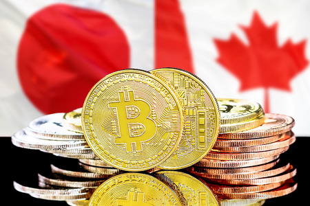 Bitcoins on the background of the flag Japan and Canada. Concept for investors in cryptocurrency and Blockchain technology in the Japan and Canada. Zdjęcie Seryjne