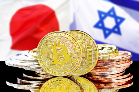 Bitcoins on the background of the flag Israel and Japan. Concept for investors in cryptocurrency and Blockchain technology in the Israel and Japan.