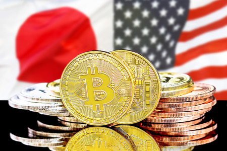 Bitcoins on the background of the flag Japan and United States of America. Concept for investors in cryptocurrency and Blockchain technology in the Japan and United States.