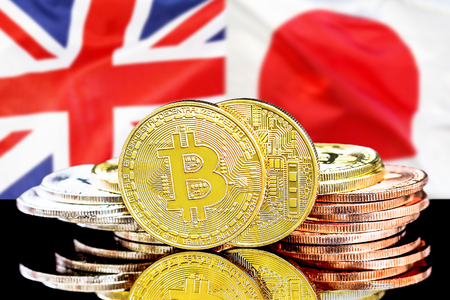Bitcoins on the background of the flag United Kingdom and Japan. Concept for investors in cryptocurrency and Blockchain technology in the United Kingdom and Japan.