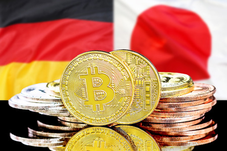 Bitcoins on the background of the flag Germany and Japan. Concept for investors in cryptocurrency and Blockchain technology in the Germany and Japan. Zdjęcie Seryjne