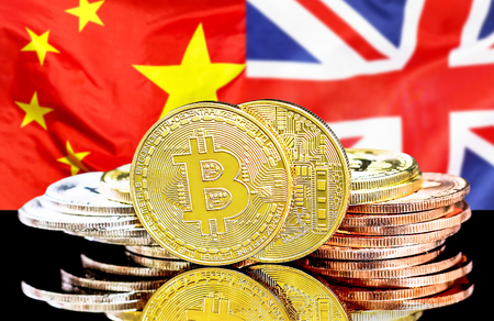Bitcoins on the background of the flag China and United Kingdom. Concept for investors in cryptocurrency and Blockchain technology in the China and United Kingdom. Stock Photo