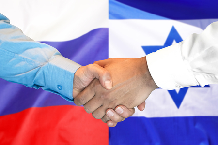Business handshake on the background of two flags. Men handshake on the background of the Israel and Russia flag. Support concept