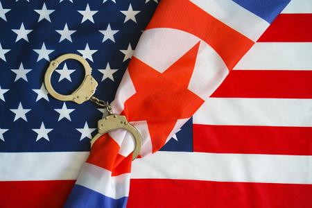 North Korea flag in handcuffs US sanctions against North Korea.