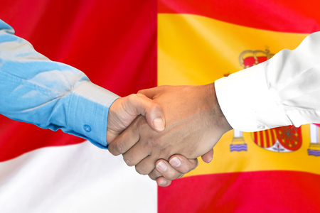 Business handshake on the background of two flags. Men handshake on the background of the Spain and Monaco flag. Support concept