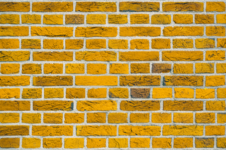 Yellow Brick wall background or texture. New yellow brick wall texture background