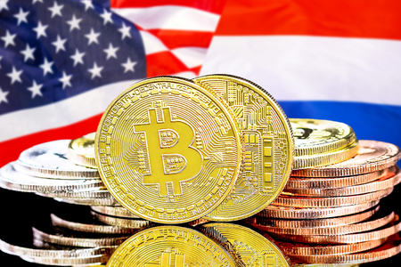 Concept for investors in cryptocurrency and Blockchain technology in the Netherlands and United States of America. Bitcoins on the background of the flag Dutch and United States of America.