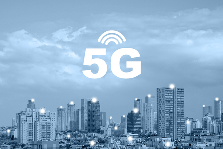 Communication network concept 5G smart city on blue background. 5G network wireless systems and internet of things with modern city. 5G network wireless systems connect global wireless devices in city.
