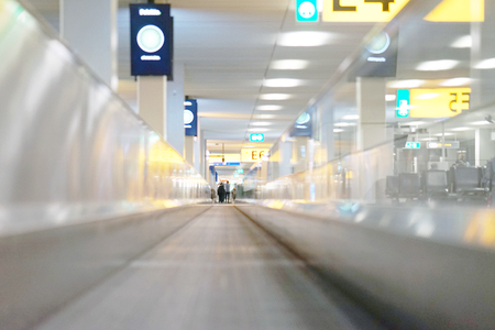 Moving walkway, moving sidewalk, moving pavement, autopedescalator, walkalator, travelator, horizontal escalator, slidewalk, or moveator at an airport.