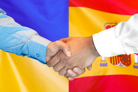 Business handshake on the background of two flags. Men handshake on the background of the Spain and Ukraine flag. Support concept