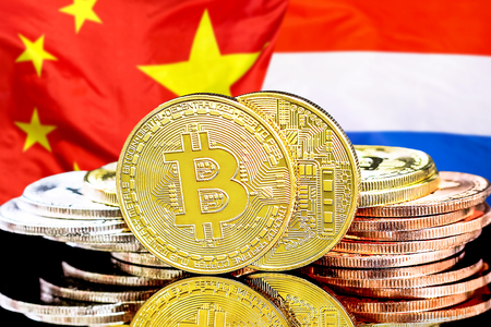 Concept for investors in cryptocurrency and Blockchain technology in the Netherlands and China. Bitcoins on the background of the flag Dutch and China.