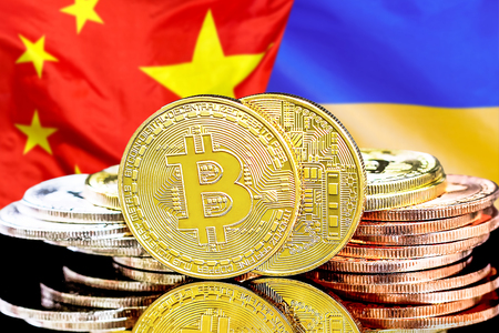 Concept for investors in cryptocurrency and Blockchain technology in the Ukraine and China. Bitcoins on the background of the flag Ukraine and China.