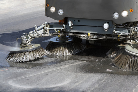 Street sweeper machine working. Street cleaning machine. Foto de archivo