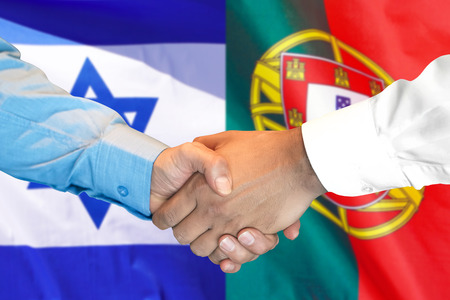 Business handshake on the background of two flags. Men handshake on the background of the Portugal and Israel flag. Support concept