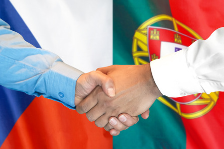 Business handshake on the background of two flags. Men handshake on the background of the Portugal and Czech Republic flag. Support concept