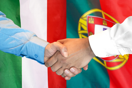 Business handshake on the background of two flags. Men handshake on the background of the Portugal and Ukraine flag. Support concept Zdjęcie Seryjne