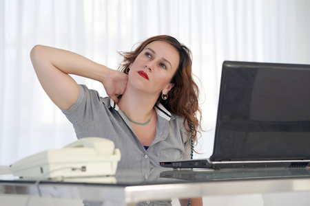 Tired Neck. Social worker. Office worker Woman Suffering From Neck Pain. Female Feeling Tired, Exhausted, Stressed. Girl Massaging Painful Neck With Hands. Body And Health Care Concept.
