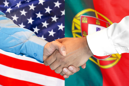 Business handshake on the background of two flags. Men handshake on the background of the Portugal and United States of America flag. Support concept