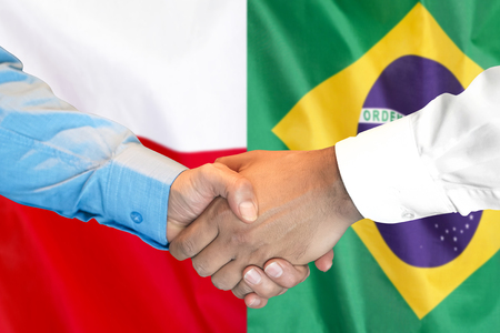 Business handshake on the background of two flags. Men handshake on the background of the Brazil and Poland flag. Support concept Zdjęcie Seryjne