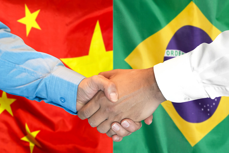 Business handshake on the background of two flags. Men handshake on the background of the Brazil and China flag. Support concept Zdjęcie Seryjne