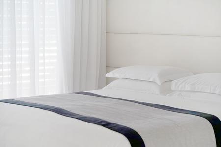 Modern bedroom interior in the hotel. Interior of a hotel bedroom