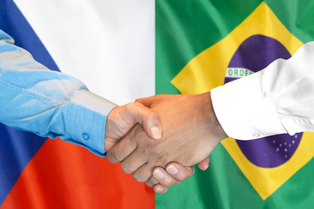 Business handshake on the background of two flags. Men handshake on the background of the Brazil and Czech Republic flag. Support concept Zdjęcie Seryjne