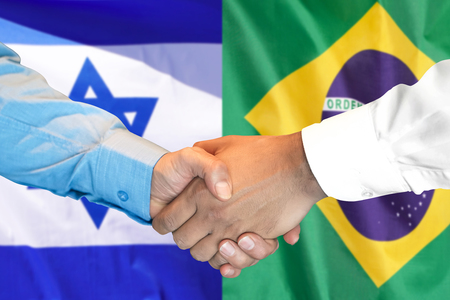Business handshake on the background of two flags. Men handshake on the background of the Brazil and Israel flag. Support concept