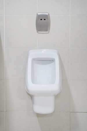 Close-up of toilet bowl. White toilet in the bathroom. Public toilet in the airport or restaurant, cafe. Stock Photo