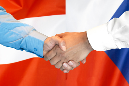 Business handshake on the background of two flags. Men handshake on the background of the Austria and Czech Republic flag. Support concept