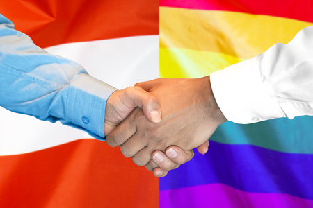 Business handshake on the background of two flags. Men handshake on the background of the Austria and LGBT gay flag. Flag of tolerance. Support concept